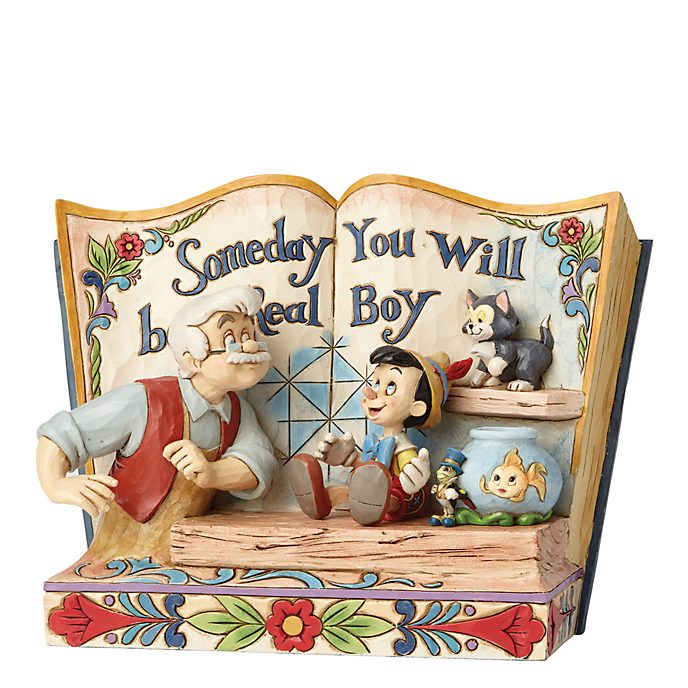 Figurita libro Pinocho, Disney Traditions, Enesco